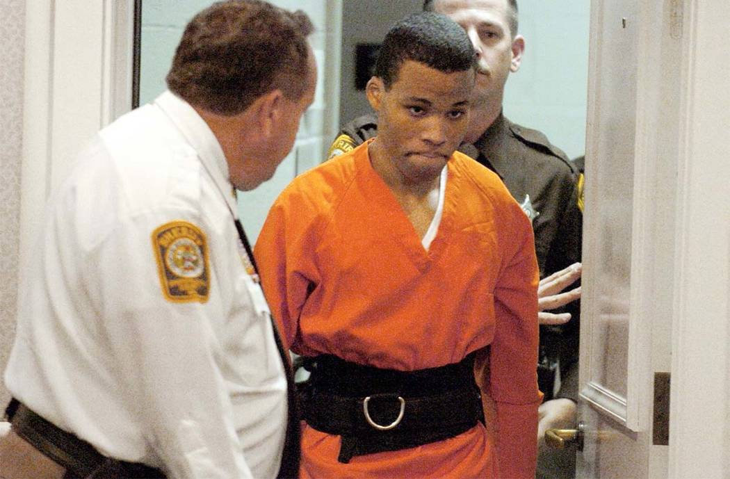 Lee Boyd Malvo enters a courtroom in the Spotsylvania, Va., Circuit Court on Oct. 26, 2004. A federal judge has tossed out two life sentences for Malvo and ordered Virginia courts to hold new sent ...