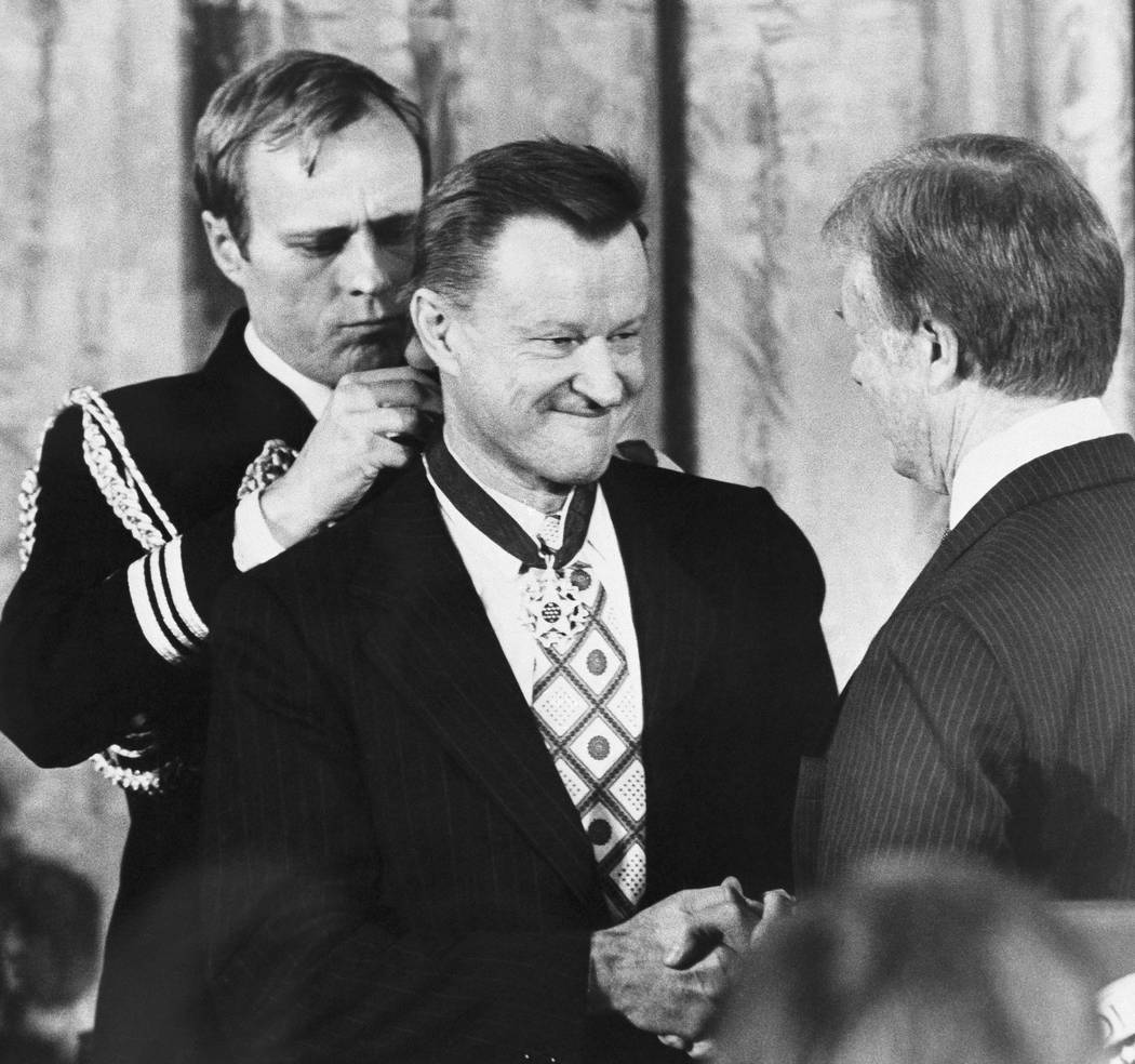 FILE - In this Jan. 17, 1981 file photo, President Jimmy Carter shakes hands with his national security adviser, Zbigniew Brzezinski, as he presents Brzezinski with the Medal of Freedom at a White ...