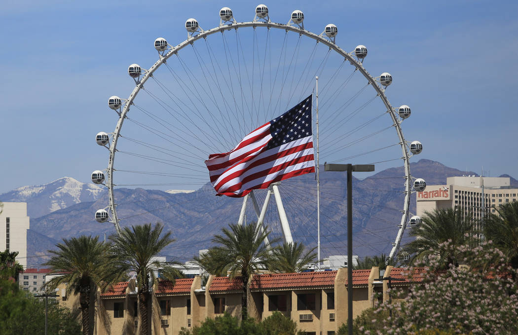 An American flag, framed by the High Roller, flutters in the breeze in Las Vegas on Thursday, April 27, 2017. Brett Le Blanc Las Vegas Review-Journal @bleblancphoto