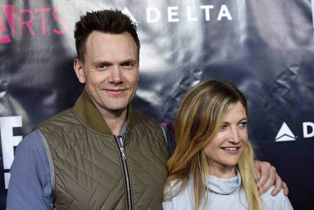 "Actor Joel McHale and his wife Sarah Williams pose together at the 2017 P.S. ARTS ""The pARTy!"" at NeueHouse on Thursday, May 4, 2017, in Los Angeles. (Chris Pizzello/Invision/AP)"