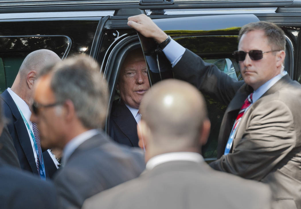 US President Donald Trump prepares to get off his car as he arrives for a G7 session with outreach countries in Taormina, Italy, Saturday, May 27, 2017. (Salvatore Cavalli/AP)