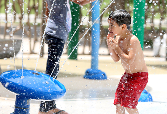 Taylor Bools, 4, cools himself as he plays at Sunset Park on Thursday, June 9, 2016, during a hot day. The Las Vegas Valley will continue to be warm and sunny this week, reaching triple digits Tue ...