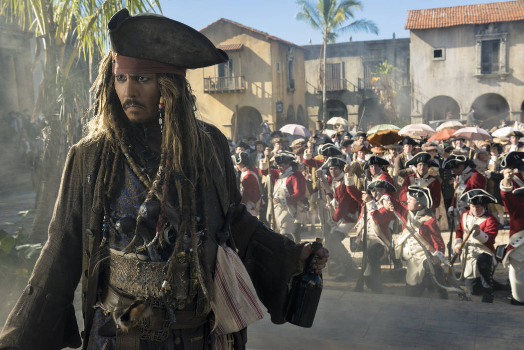 "Johnny Depp stars as Captain Jack Sparrow in ""Pirates of the Caribbean: Dead Men Tell No Tales"" (Peter Mountain/Disney Enterprises, Inc.)"
