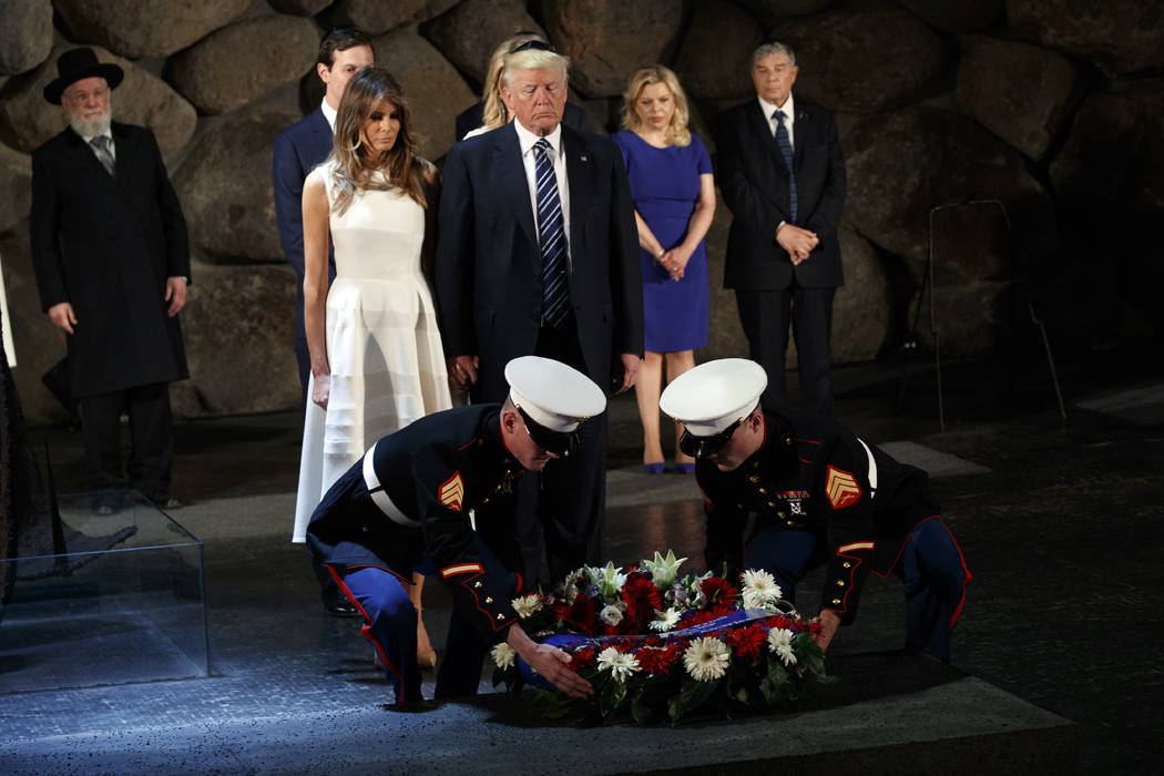 In this May 23, 2017, photo, President Donald Trump and first lady Melania Trump lay a wreath at Yad Vashem to honor the victims of the holocaust in Jerusalem. As he dashed through the Middle East ...