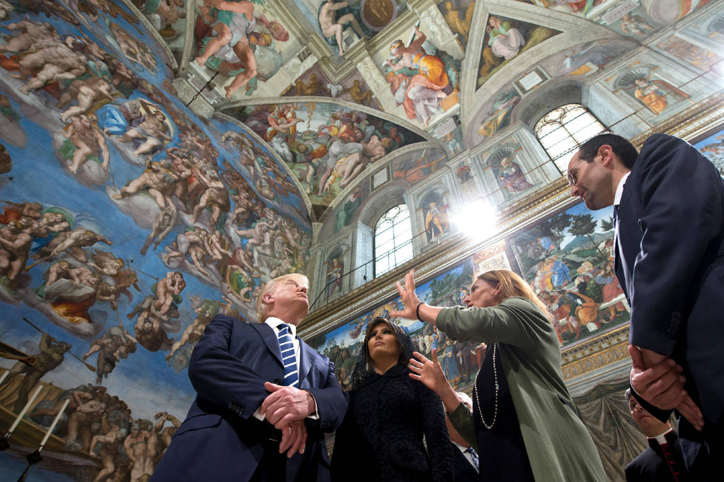 President Donald Trump and his wife Melania, left, listen to a guide May 24, 2017, as they look at the frescoed ceilings during their visit to the Sistine Chapel of the Vatican Museums, at the Vat ...