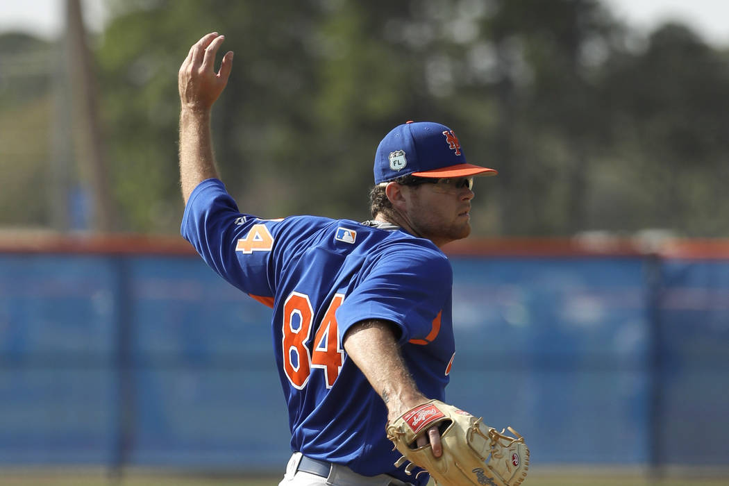 New York Mets pitcher David Roseboom goes through a drill during a spring training baseball workout Wednesday, Feb. 15, 2017, in Port St. Lucie, Fla. (AP Photo/David J. Phillip)
