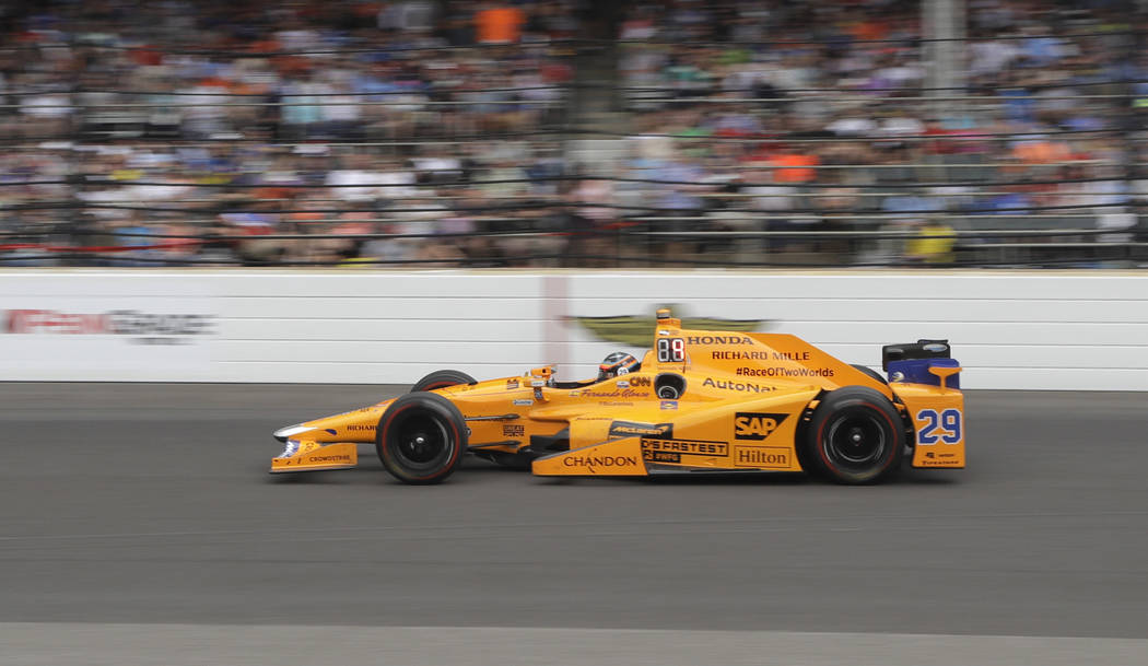 Fernando Alonso, of Spain, heads into the first turn during the running of the Indianapolis 500 auto race at Indianapolis Motor Speedway, Sunday, May 28, 2017, in Indianapolis. (Darron Cummings/AP)