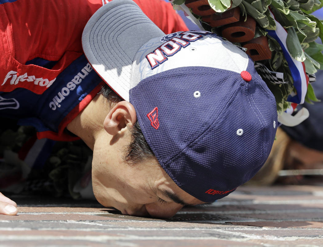 Takuma Sato, of Japan, kisses the Yard of Bricks on the start/finish line after winning the Indianapolis 500 auto race at Indianapolis Motor Speedway, Sunday, May 28, 2017 in Indianapolis. (Darron ...