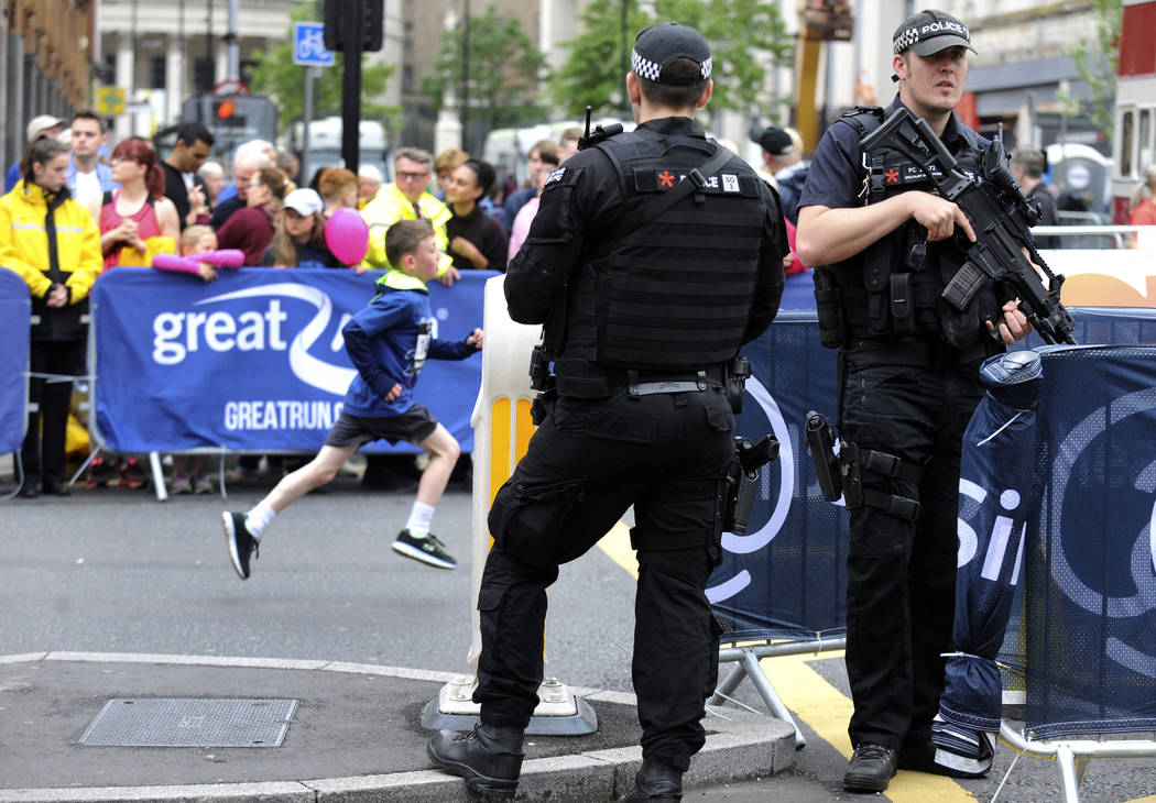 Armed police guard the area during the Great Manchester Run in Manchester, England Sunday, May 28, 2017. (Rui Vieira/AP)