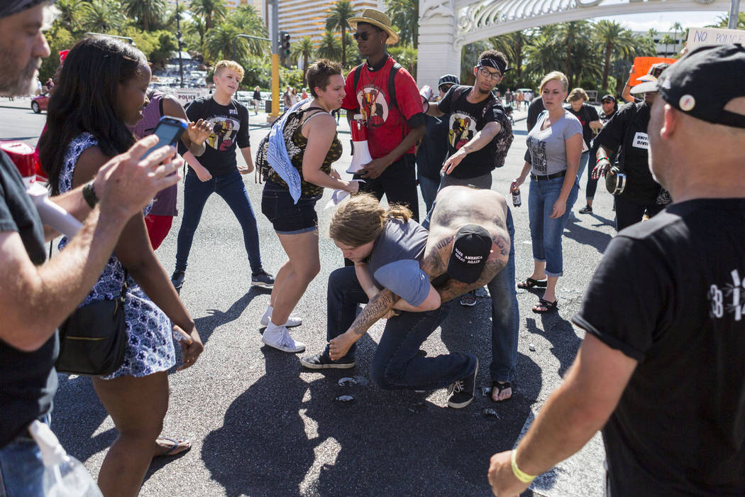 A fight breaks out while protesters block Las Vegas Boulevard in front of The Venetian to protest the officer involved death of Tashii Brown, in Las Vegas, Sunday, May 28, 2017. Elizabeth Brumley/ ...