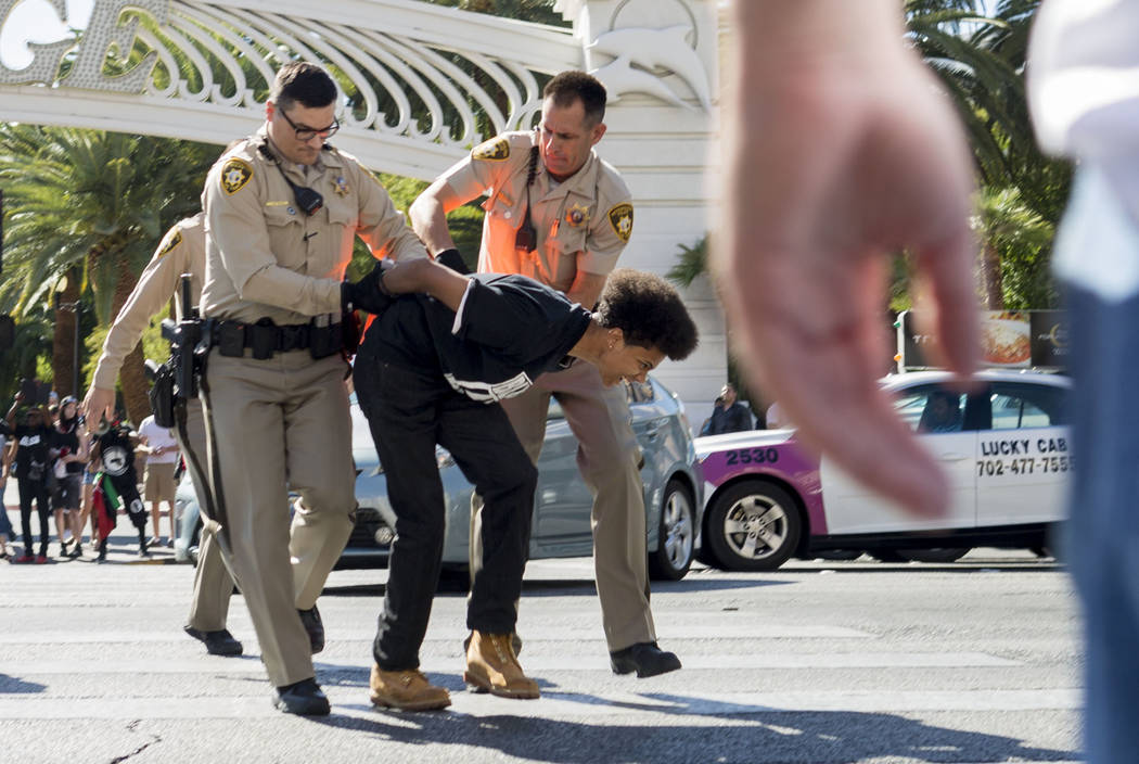 Protester is arrested after blocking Las Vegas Boulevard in front of The Venetian in protest of the death of Tashii Brown in Las Vegas, Sunday,  May 28, 2017.  Elizabeth Brumley/Las Vegas Review-J ...