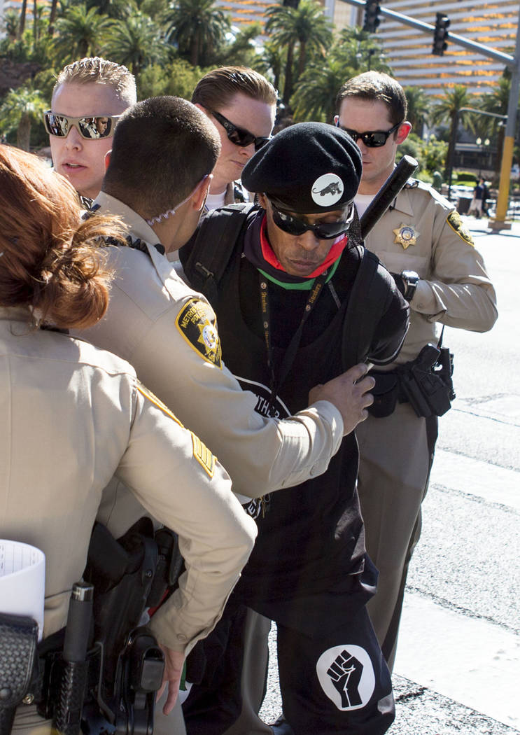 Jay Jackson with the New Black Panther Party is arrested during a protest that blocked Las Vegas Boulevard in front of The Venetian in Las Vegas, Sunday, May 28, 2017.  Elizabeth Brumley/Las Vegas ...