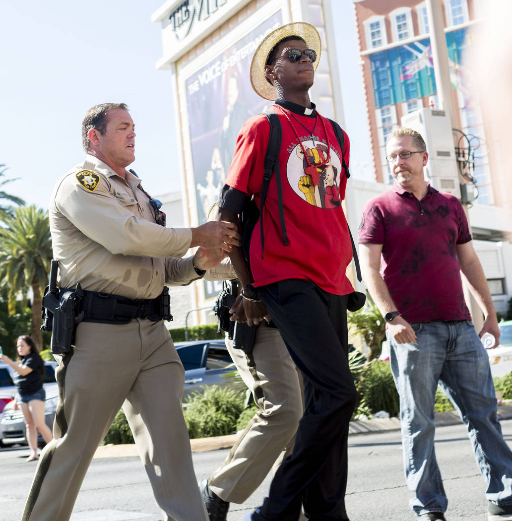 Stretch Sanders, founder and president of All Shades United Las Vegas, is arrested during protest on Las Vegas Boulevard in front of The Venetian to protest the police involved death of Tashii Bro ...