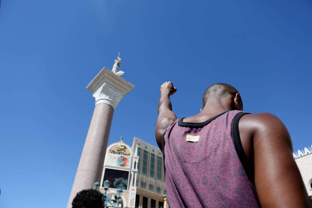 A protester in the beginning of their declaration against the police involved death of Tashii Brown, in front of The Venetian in Las Vegas, Sunday, May 28, 2017.  Elizabeth Brumley/Las Vegas Revie ...
