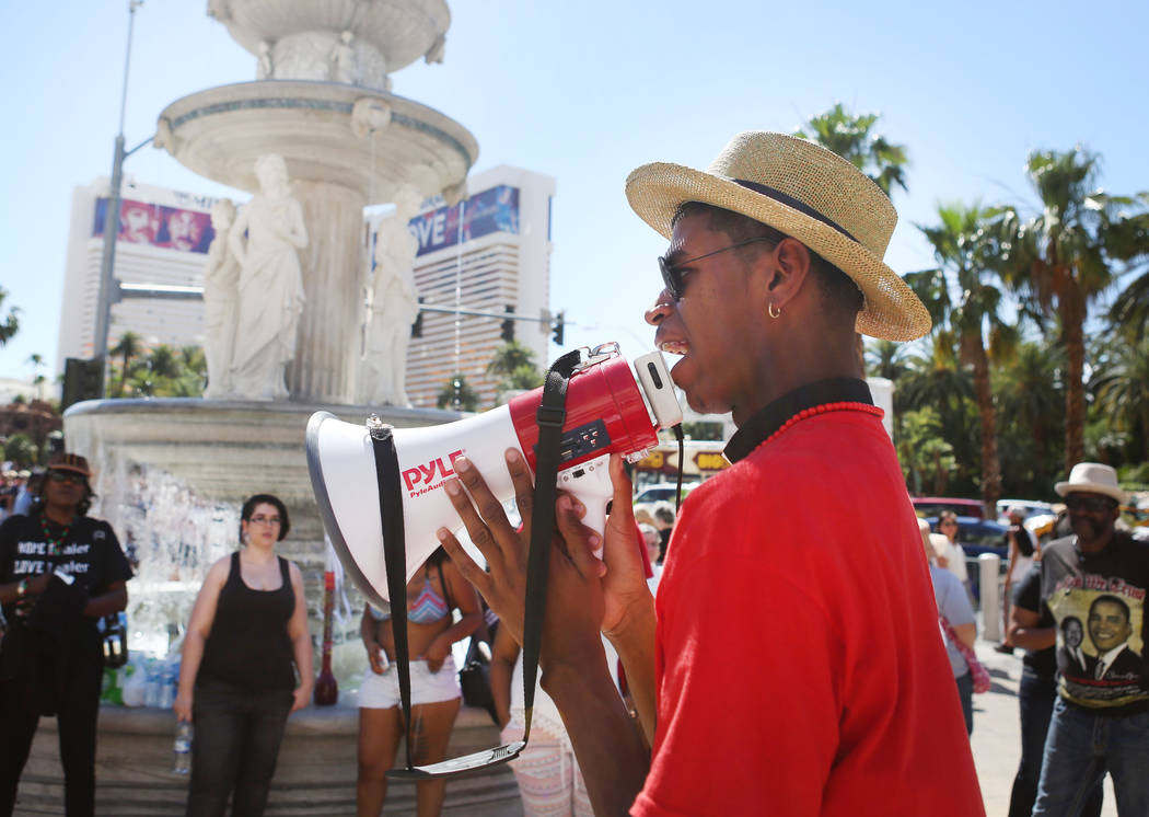 Stretch Sanders, founder and president of All Shades United Las Vegas, leads protesters in front of The Venetian to protest the police involved death of Tashii Brown, in Las Vegas, Sunday, May 28, ...