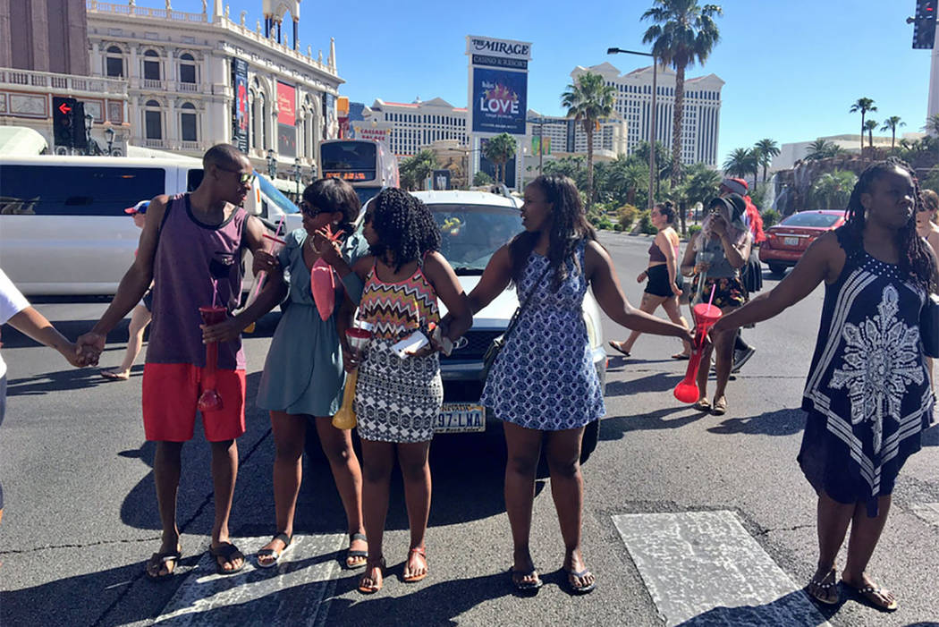 10 arrested after fight during Vegas protest of man's death