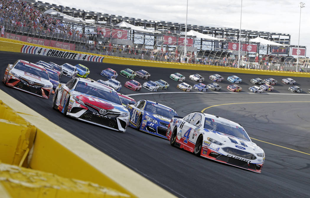 Kevin Harvick (4) and Kyle Busch (18) lead the field for the start of the NASCAR Cup series auto race at Charlotte Motor Speedway in Concord, N.C., Sunday, May 28, 2017. (AP Photo/Chuck Burton)