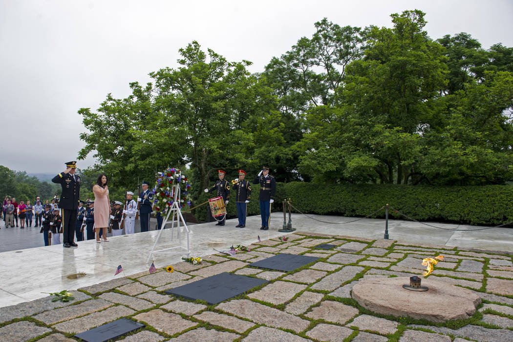 Army Major Gen. Michael Howard, commanding general of the Military District of Washignton, far left, and Karen Durham-Aquilera, executive director of Army National Cemeteries, lay a wreath at the  ...