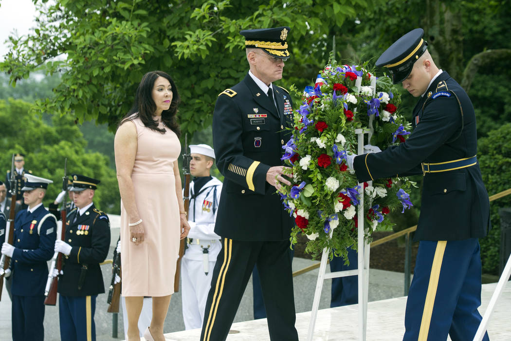 Army Major Gen. Michael Howard, commanding general of the Military District of Washignton, right, and Karen Durham-Aquilera, executive director of Army National Cemeteries, left, lay a wreath at t ...