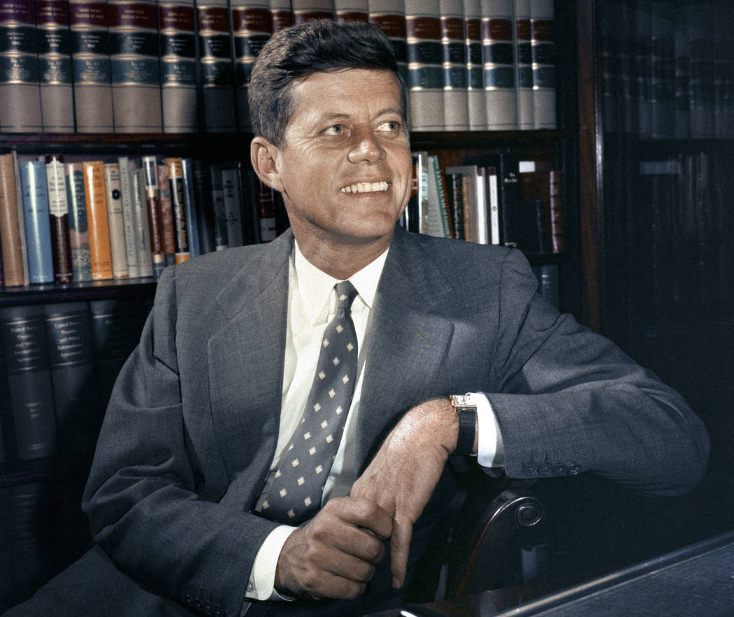 In this Feb. 27, 1959 file photo, Sen. John F. Kennedy, D-Mass., is shown in his office in Washington. Monday, May 29, 2017 marks the 100-year anniversary of the birth of Kennedy, who went on to b ...