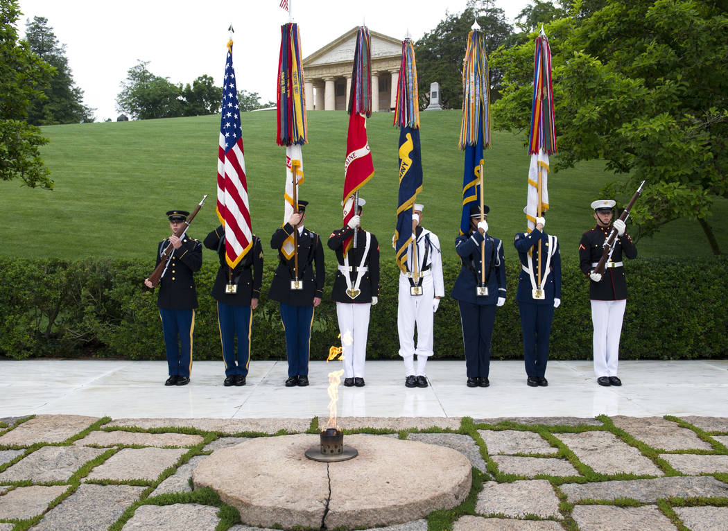 The Army Old Guard color guard stands watch during a wreath laying ceremony, at the grave of former President John F. Kennedy, to mark the 100th anniversary of his birth, at Arlington National Cem ...