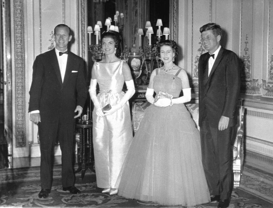 In this June 5, 1961 file photo, Queen Elizabeth II poses with U.S. President John F. Kennedy, before a state dinner at Buckingham Palace. At left is the Duke of Edinburgh and Kennedy's wife, Jack ...