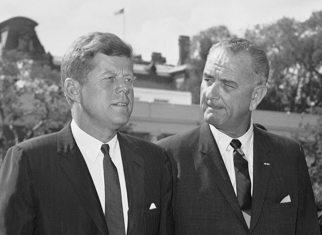 In this Aug. 22, 1962 file photo, President John F. Kennedy walks with Vice President Lyndon Johnson, right, on the White House south grounds as Johnson started a trip to Italy and the Middle East ...