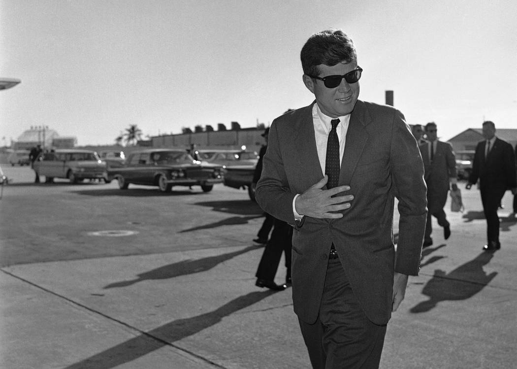 In this Dec. 18, 1961 file photo, President John F. Kennedy heads for Washington after an overnight stopover in West Palm Beach, Fla., where he rested after his Latin American tour due to a heavy  ...