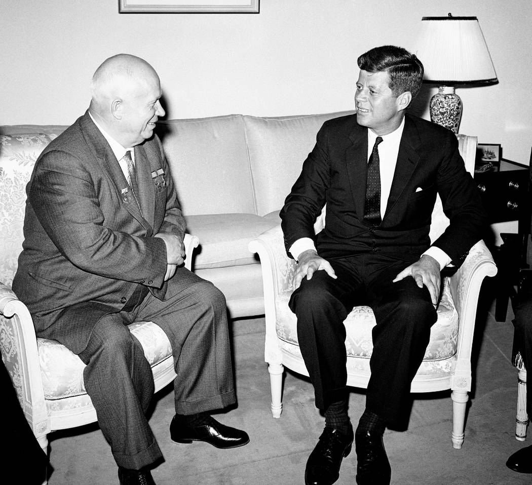 In this June 3, 1961, file photo, Soviet Premier Nikita Khrushchev and President John F. Kennedy talk in the residence of the U.S. Ambassador in a suburb of Vienna. The meeting was part of a serie ...