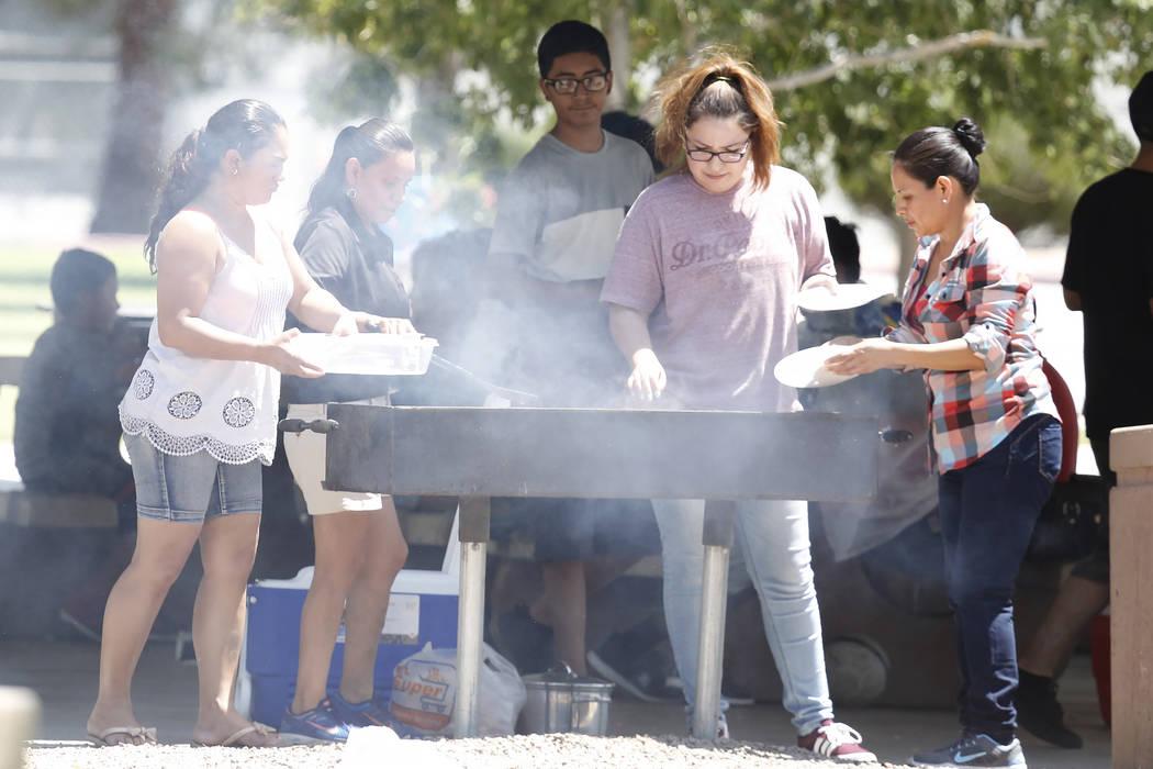 People barbecue at Lorenzi Park during a hot Memorial Day on Monday, May 29, 2017, in Las Vegas. (Bizuayehu Tesfaye/Las Vegas Review-Journal) @bizutesfaye