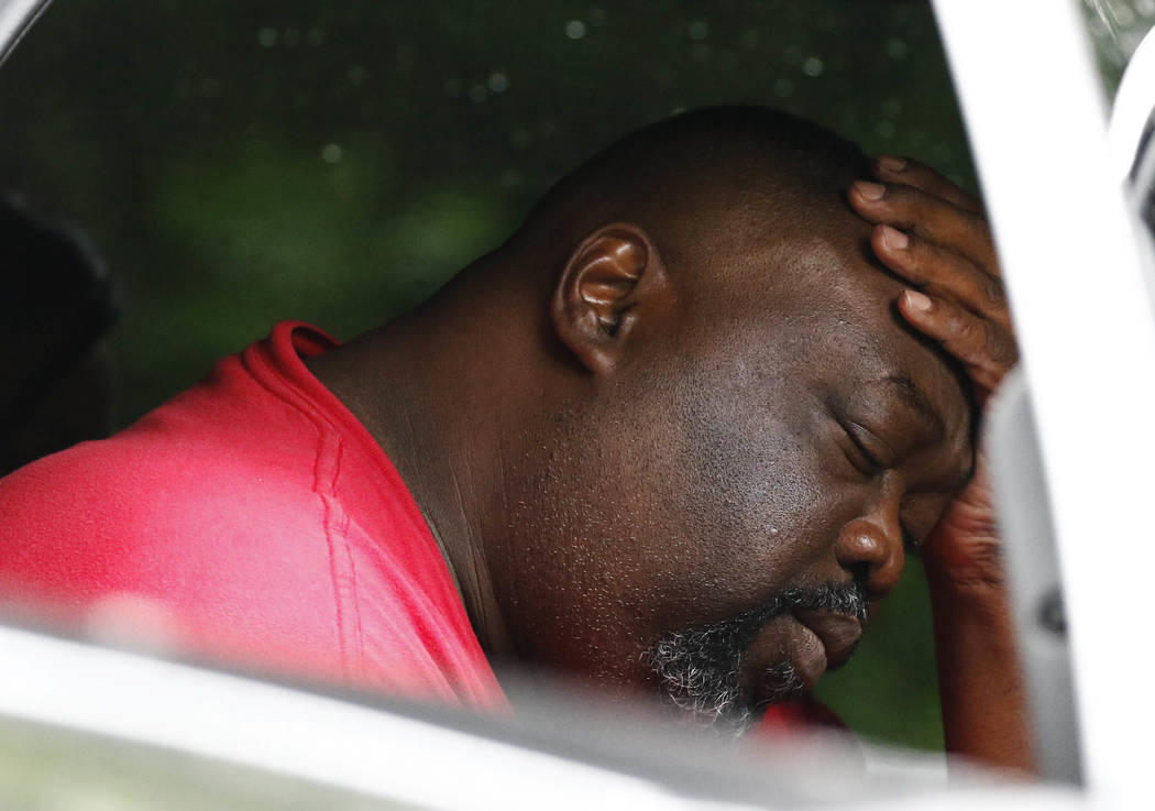Vincent Mitchell reflects on his escape and the deaths of family members Sunday, May 28, 2017, outside his Bogue Chitto, Miss., home. A man was arrested Sunday in a house-to-house shooting rampage ...
