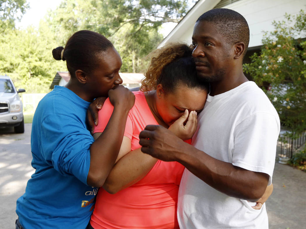 Christianna May-Kelly, center, is supported by family members as she cries after answering reporters questions outside her parents' home in Brookhaven, Miss., Sunday, May 28, 2017. May-Kelly said  ...