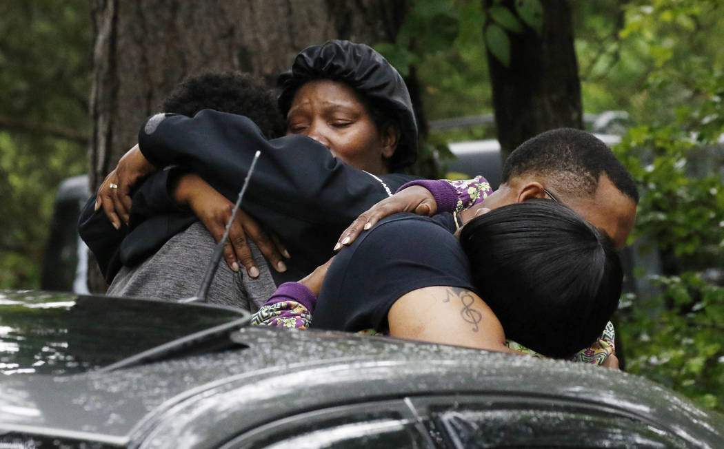 People embrace Sunday, May 28, 2017, outside a Bogue Chitto, Miss., house where several people were fatally shot during a house-to-house shooting rampage Saturday in Lincoln County, Miss. A man wa ...