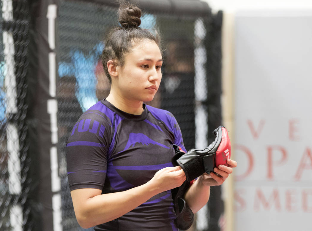 UFC strawweight Jamie Moyle puts on her gloves for a training session at Syndicate MMA in Las Vegas on Wednesday, May 24, 2017. Heidi Fang/Las Vegas Review-Journal @HeidiFang
