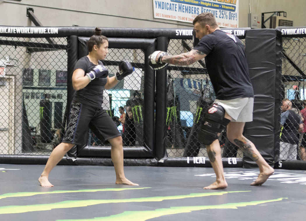 UFC strawweight Jamie Moyle, left, hits mitts with Syndicate MMA head coach and gym owner John Wood at his gym in Las Vegas on Wednesday, May 24, 2017. Heidi Fang/Las Vegas Review-Journal @HeidiFang