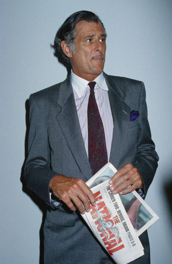 Frank Deford, editor and publisher of The National Sports Daily, holds a proof of the final front page of the newspaper June 12, 1991, after a news conference at the paper's offices in New York. ( ...