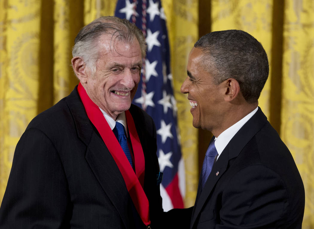 President Barack Obama laughs with Frank Deford on July 10, 2013, as he awards him the 2012 National Humanities Medal during a ceremony in the East Room of White House in Washington. (Carolyn Kast ...