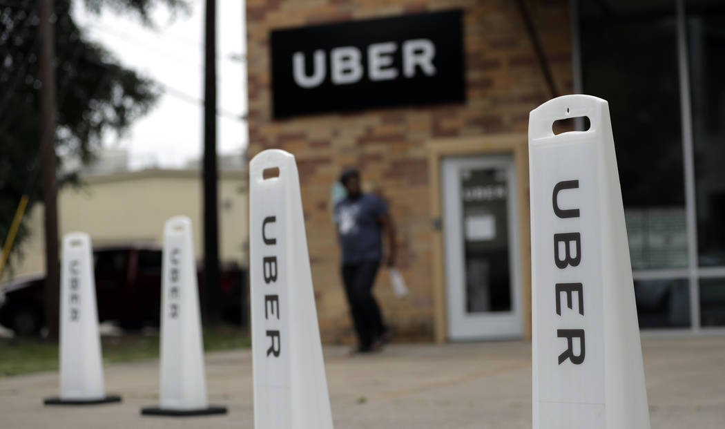 In this Friday, May 26, 2017 photo, a man exits the Uber offices in Austin, Texas.  (AP Photo/Eric Gay, file)