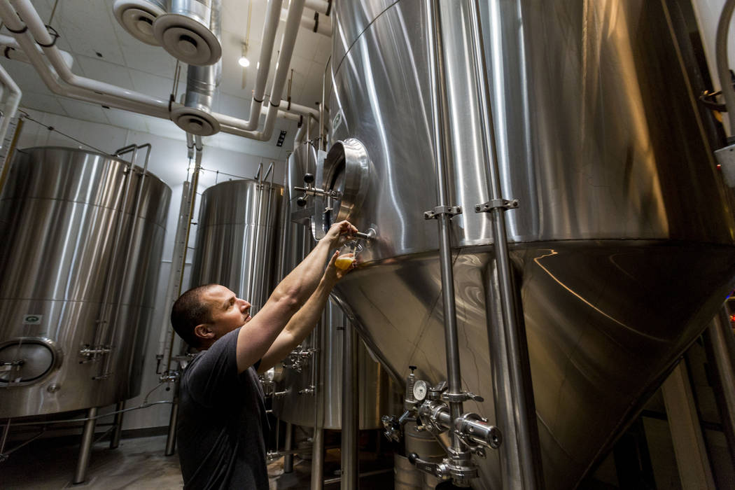 Co-founder of Banger Brewing Nick Fischell gets a sample of their new Cinco De Meyo beer that is brewing at Barley's Casino & Brewing Company in Henderson, Monday, April 3, 2017. (Elizabeth Br ...