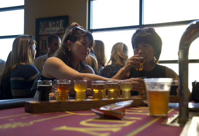 Yumi Morgan, left, and Hidemi Slyman taste a variety of beers during the grand opening of Lovelady Brewery and Taproom in downtown Henderson on Friday, April 1, 2016. (Daniel Clark/Las Vegas Revie ...