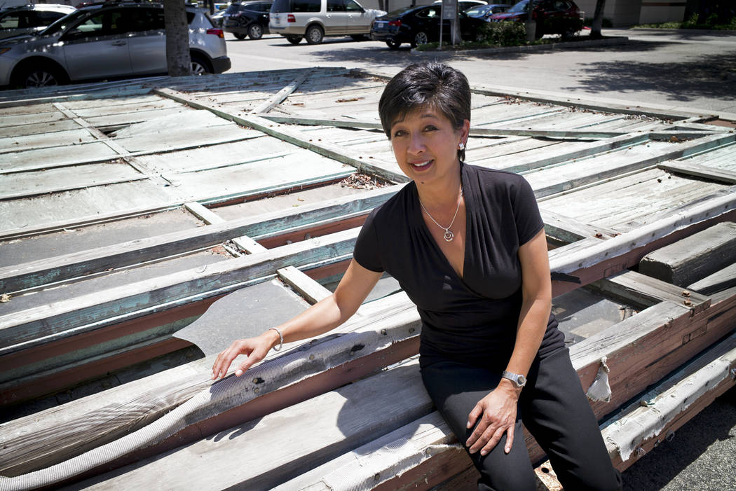 """Christine Dunn with part of the disassembled hangar facade that framed the opening scene of the 1942 film """"Casablanca,"""" May 23, 2017. (David Crane/Los Angeles Daily News via AP)"""