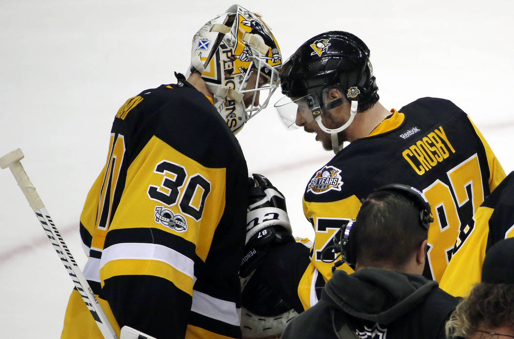 Pittsburgh Penguins' captain Sidney Crosby, right, speaks to Pittsburgh Penguins' goalie Matt Murray after their 5-3 win over the Nashville Predators in Game 1 of the NHL hockey Stanley Cup Finals ...