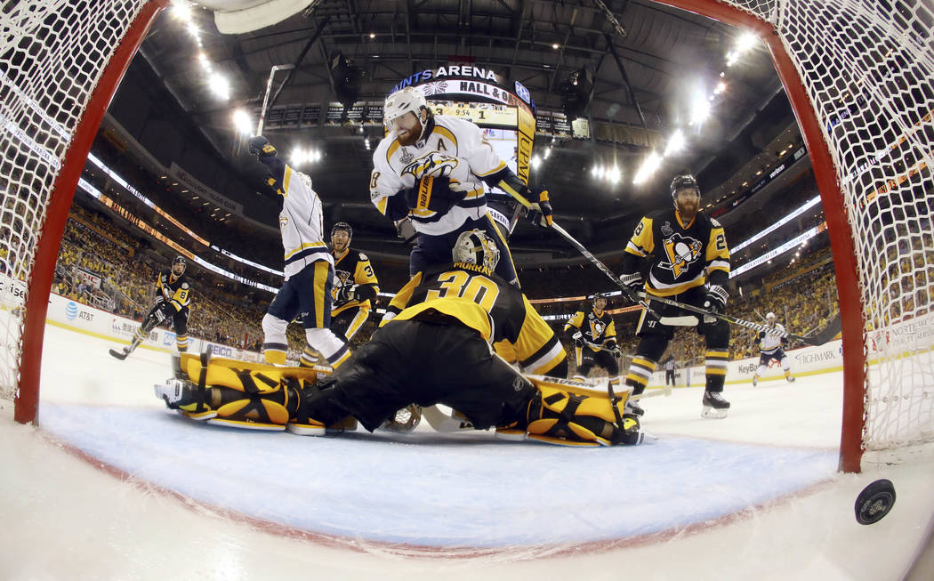 Nashville Predators' Colton Sissons left, celebrates his goal past Pittsburgh Penguins' goalie Matt Murray (30) during the third period in Game 1 of the NHL hockey Stanley Cup Finals, Monday, May  ...