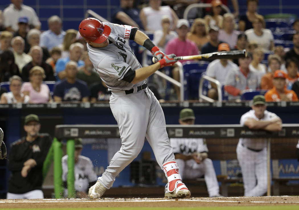 Los Angeles Angels' Mike Trout hits a solo home run during the first inning of an interleague baseball game against the Miami Marlins, Saturday, May 27, 2017, in Miami. (AP Photo/Lynne Sladky)