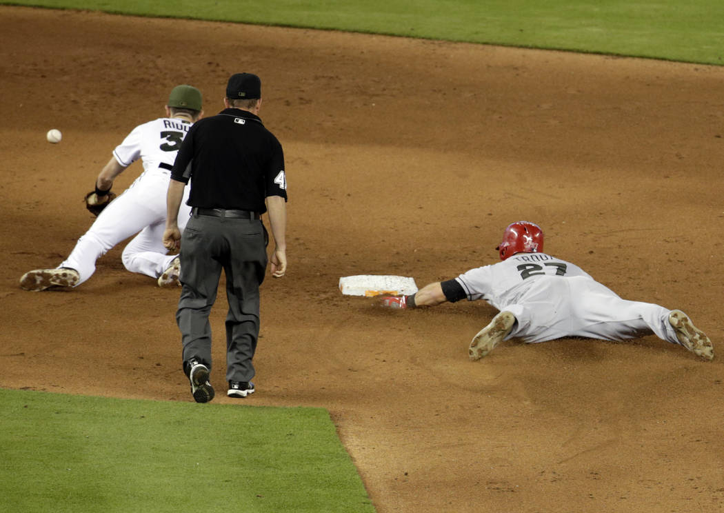 Los Angeles Angels' Mike Trout (27) steals second as the ball gets away from Miami Marlins shortstop JT Riddle during the fifth inning of an interleague baseball game, Sunday, May 28, 2017, in Mia ...