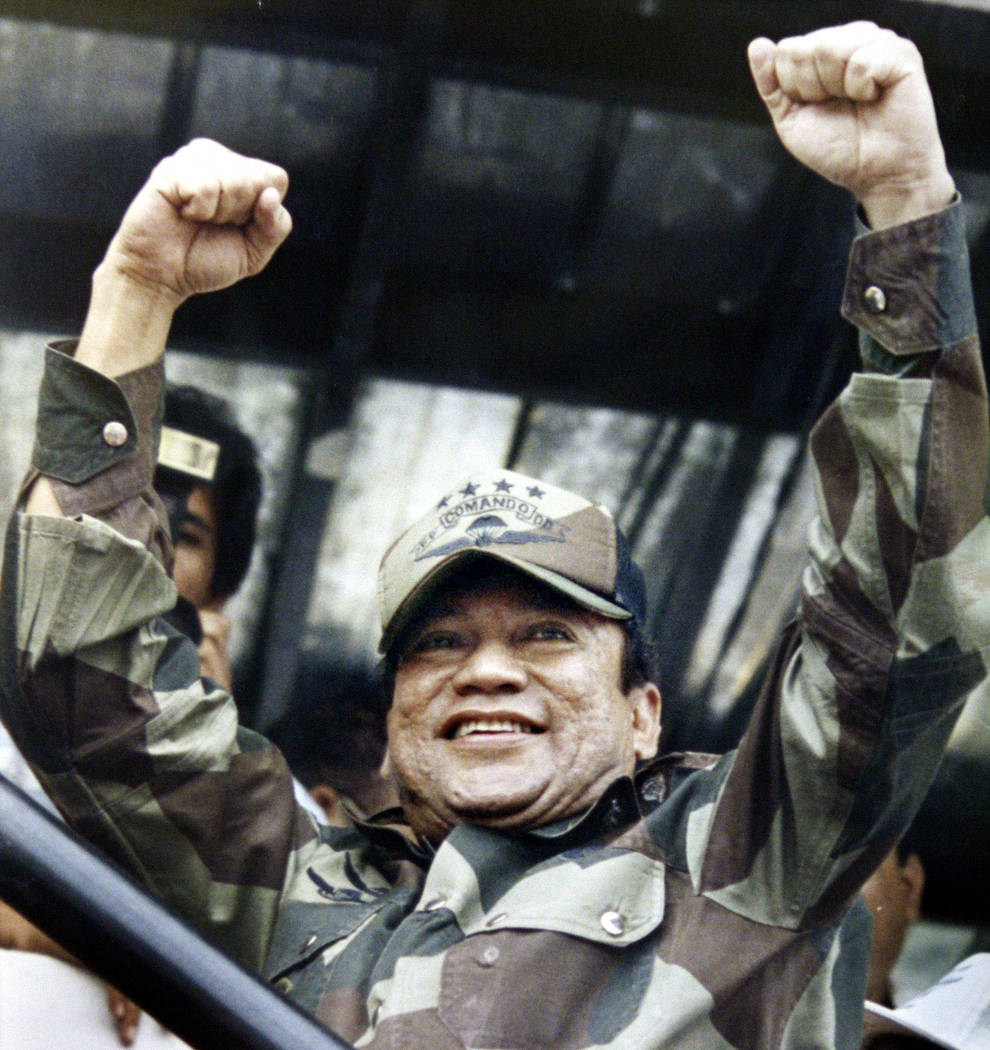 In this May 20, 1988 file photo, Panamanian military strongman Gen. Manuel Noriega raises his fists to acknowledge the crowd cheers during a Dignity Battalion rally in Panama City. Panama's ex-dic ...