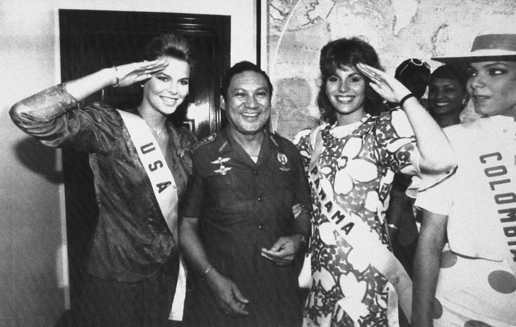 FIn this July 5, 1986 file photo, Miss USA, Christy Fichtner, left, and Miss Panama, Gilda Garcia Lopez, salute while flanking General Manuel Antonio Noriega in Panama City. Pictured right is Miss ...