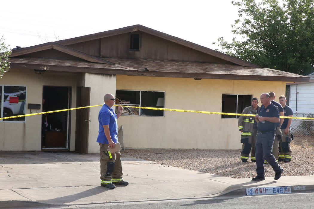 Henderson firefighters investigate the scene of a house fire that killed a man on the 200 block of West Basic Road, near West Lake Mead Parkway on Tuesday, May 30, 2017, in Henderson. (Bizuayehu T ...