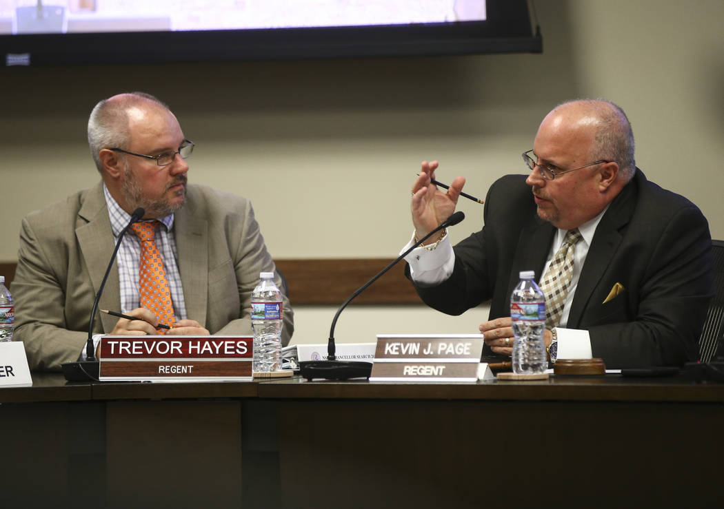 Nevada System of Higher Education Regent Kevin Page, right, speaks as Regent Trevor Hayes looks on during a chancellor search committee meeting at the NSHE administration office in Las Vegas on We ...