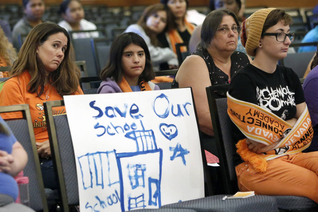 Parents and students, including Nevada Connections Academy student, Caitlin Droegemueller, 7, second left, and her mother Dianna Thompson, second right, attend the State Public Charter School Auth ...